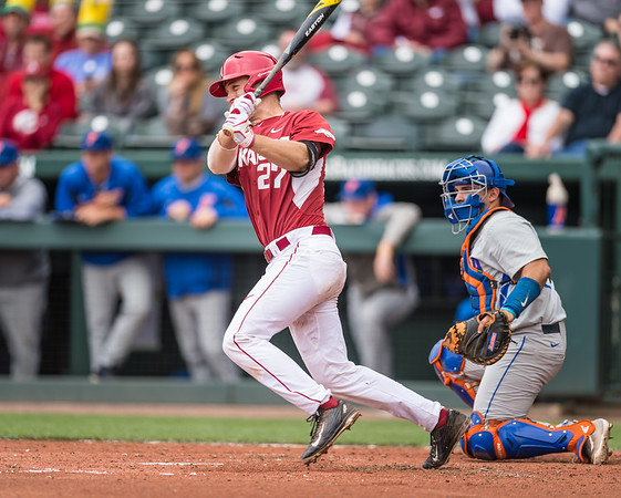 Arkansas catcher Tucker Pennell (27) bats during a baseball game between Arkansas and Florida on 4/16/2016.   (Alan Jamison, Nate Allen Sports Service)