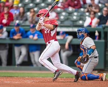 Arkansas catcher Tucker Pennell (27) bats during a baseball game between Arkansas and Florida on 4/16/2016.   (Alan Jamison, Nate Allen Sports Service)