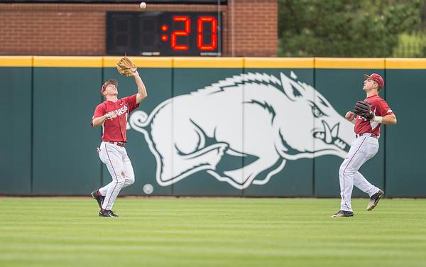 Arkansas outfielder Clark Eagan (9) catches a fly ball during a baseball game between Arkansas and Florida on 4/16/2016.   (Alan Jamison, Nate Allen Sports Service)