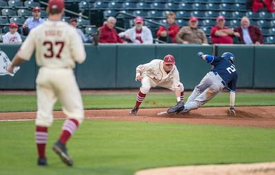 Arkansas infielder Cody Scroggins (5) tags out Creighton outfielder Daniel Woodrow (2) at third base during a baseball game between Arkansas and Creighton on 4/19/2016.   (Alan Jamison, Nate Allen Sports Service)