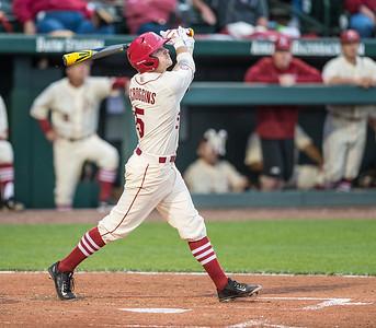 Arkansas infielder Cody Scroggins (5) bats during a baseball game between Arkansas and Creighton on 4/19/2016.   (Alan Jamison, Nate Allen Sports Service)
