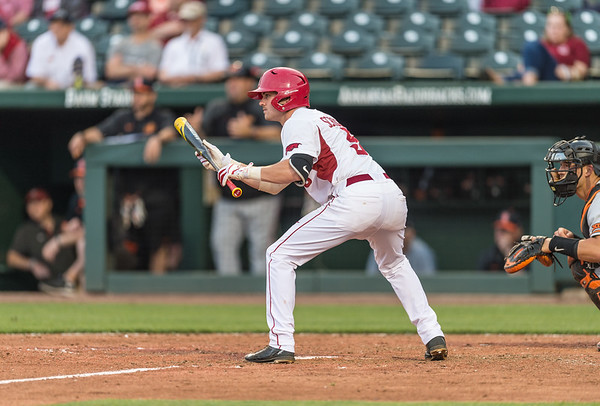 Arkansas infielder Cody Scroggins (5) squares to bunt during a baseball game between Arkansas and Oklahoma State University on 4/26/2016.   (Alan Jamison, Nate Allen Sports Service)