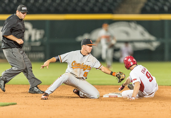 Arkansas outfielder Clark Eagan (9) slides in to second base for a double ahead of the tag by Oklahoma State infielder Donnie Walton (5) during a baseball game between Arkansas and Oklahoma State University on 4/26/2016.   (Alan Jamison, Nate Allen Sports Service)