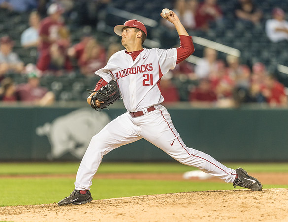 Arkansas pitcher Kacey Murphy (21) pitches during a baseball game between Arkansas and Oklahoma State University on 4/26/2016.   (Alan Jamison, Nate Allen Sports Service)