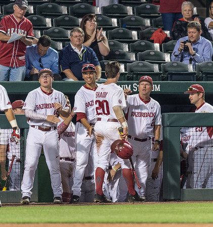Arkansas catcher Carson Shaddy (20) is congratulated by head coach Dave Van Horn after scoring during a baseball game between Arkansas and Oklahoma State University on 4/26/2016.   (Alan Jamison, Nate Allen Sports Service)