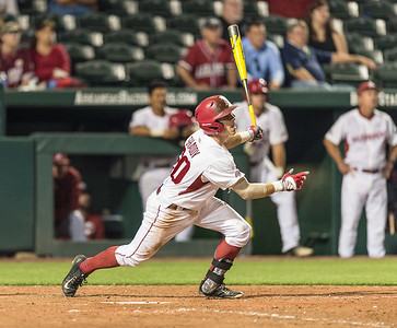 Arkansas catcher Carson Shaddy (20) bats during a baseball game between Arkansas and Oklahoma State University on 4/26/2016.   (Alan Jamison, Nate Allen Sports Service)
