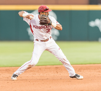 Arkansas infielder Michael Bernal (3) throws to first base during a baseball game between Arkansas and Oklahoma State University on 4/26/2016.   (Alan Jamison, Nate Allen Sports Service)