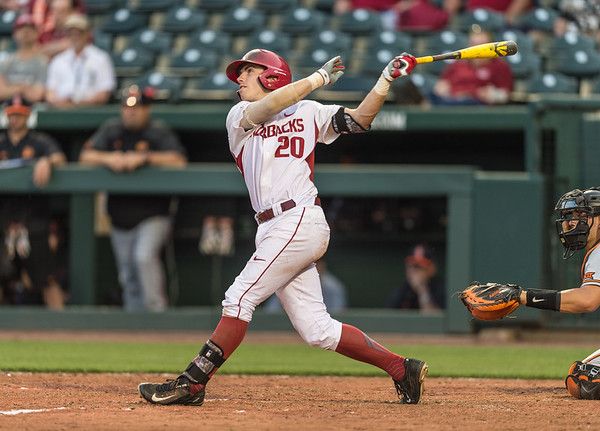 Arkansas catcher Carson Shaddy (20) hits during a baseball game between Arkansas and Oklahoma State University on 4/26/2016.   (Alan Jamison, Nate Allen Sports Service)