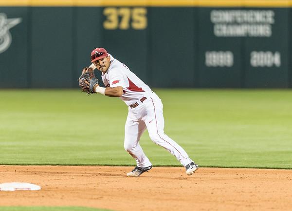 Arkansas infielder Michael Bernal (3) throws to first base during a baseball game between Arkansas and Oklahoma State University on 4/26/2016.   (Alan Jamison, Nate Allen Sports Service)