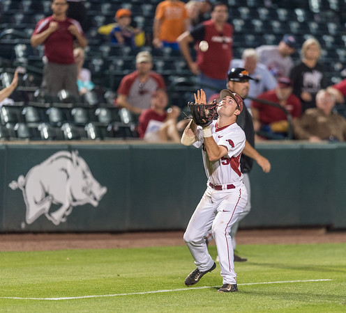 Arkansas infielder Cody Scroggins (5) catches a pop up for the final out and a victory during a baseball game between Arkansas and Oklahoma State University on 4/26/2016.   (Alan Jamison, Nate Allen Sports Service)
