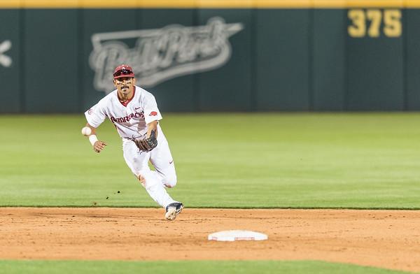 Arkansas infielder Michael Bernal (3) fields a ball during a baseball game between Arkansas and Oklahoma State University on 4/26/2016.   (Alan Jamison, Nate Allen Sports Service)
