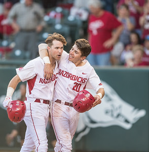 Arkansas catcher Carson Shaddy (20) congratulates Luke Bonfield after Bonfield hits a home run during a baseball game between Arkansas and Texas A&M University on 4/30/2016.   (Alan Jamison, Nate Allen Sports Service)