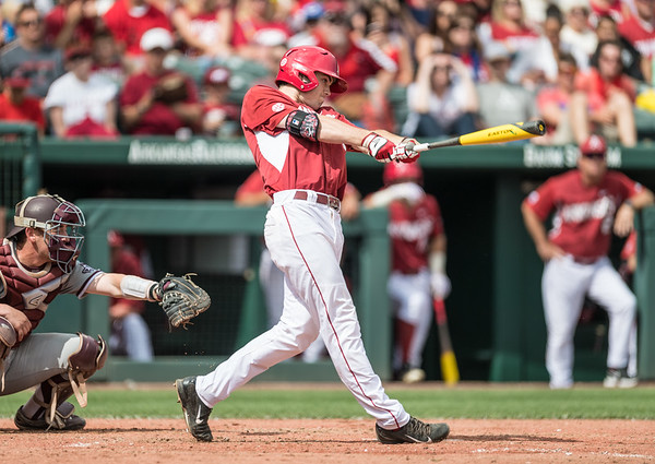 Arkansas outfielder Clark Eagan (9) hits a triple during a baseball game between Arkansas and Texas A&M University on 4/30/2016.   (Alan Jamison, Nate Allen Sports Service)