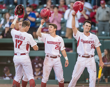 Arkansas outfielder Luke Bonfield (17) is congratulated by teammates after he hits a home run during a baseball game between Arkansas and Texas A&M University on 4/30/2016.   (Alan Jamison, Nate Allen Sports Service)