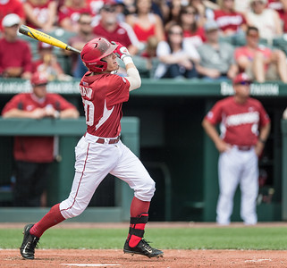 Arkansas catcher Carson Shaddy (20) hits a home run during a baseball game between Arkansas and Texas A&M University on 4/30/2016.   (Alan Jamison, Nate Allen Sports Service)