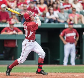 Arkansas catcher Carson Shaddy (20) hits a home run during a baseball game between Arkansas and Texas A&M University on 4/30/2016.   (Alan Jamison, Nate Allen Sports Service)