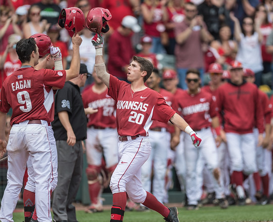 Arkansas catcher Carson Shaddy (20) celebrates a home run during a baseball game between Arkansas and Texas A&M University on 4/30/2016.   (Alan Jamison, Nate Allen Sports Service)