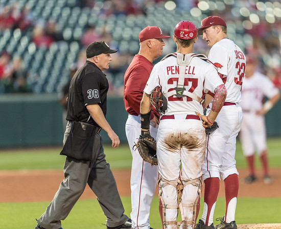 Arkansas pitching coach Dave Jorn visits Zach Jackson on the mound during a baseball game between Arkansas and Texas A&M University on 4/30/2016.   (Alan Jamison, Nate Allen Sports Service)