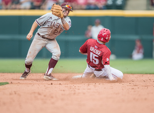 Arkansas outfielder Jake Arledge (15) avoids the tag at second base during a baseball game between Arkansas and Texas A&M University on 4/30/2016.   (Alan Jamison, Nate Allen Sports Service)