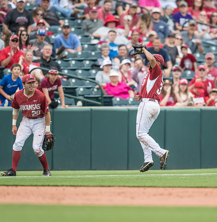 Arkansas infielder Michael Bernal (3) jumps to record an out during a baseball game between Arkansas and Texas A&M University on 4/30/2016.   (Alan Jamison, Nate Allen Sports Service)