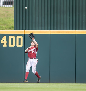 Arkansas catcher Carson Shaddy (20) fields a fly ball during a baseball game between Arkansas and Texas A&M University on 4/30/2016.   (Alan Jamison, Nate Allen Sports Service)