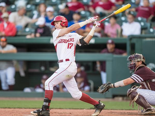 Arkansas outfielder Luke Bonfield (17) hits a home run during a baseball game between Arkansas and Texas A&M University on 4/30/2016.   (Alan Jamison, Nate Allen Sports Service)
