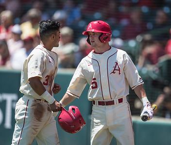 Arkansas infielder Cody Scroggins (5) congratulates Michael Bernal on a run scored during a baseball game between Arkansas and Texas A&M University on 5/1/2016.   (Alan Jamison, Nate Allen Sports Service)