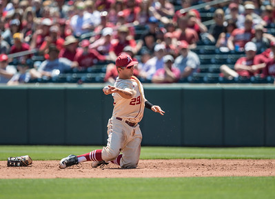 Arkansas infielder Cullen Gassaway (29) throws to first base for an out during a baseball game between Arkansas and Texas A&M University on 5/1/2016.   (Alan Jamison, Nate Allen Sports Service)