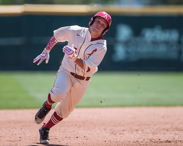 Arkansas outfielder Jake Arledge (15) heads for third base during a baseball game between Arkansas and Texas A&M University on 5/1/2016.   (Alan Jamison, Nate Allen Sports Service)