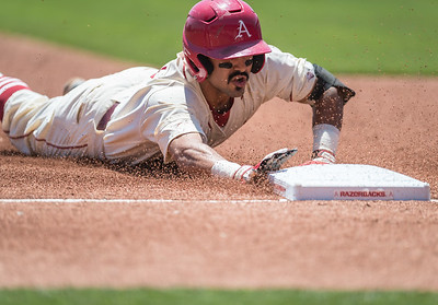 Arkansas infielder Michael Bernal (3) slides into third base for a triple during a baseball game between Arkansas and Texas A&M University on 5/1/2016.   (Alan Jamison, Nate Allen Sports Service)