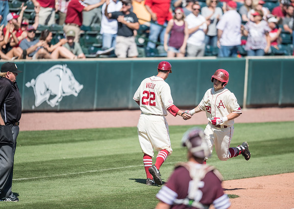 Arkansas catcher Carson Shaddy (20) hits a home run during a baseball game between Arkansas and Texas A&M University on 5/1/2016.   (Alan Jamison, Nate Allen Sports Service)