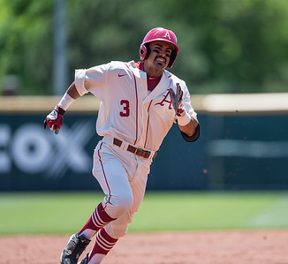 Arkansas infielder Michael Bernal (3) heads for third base during a baseball game between Arkansas and Texas A&M University on 5/1/2016.   (Alan Jamison, Nate Allen Sports Service)
