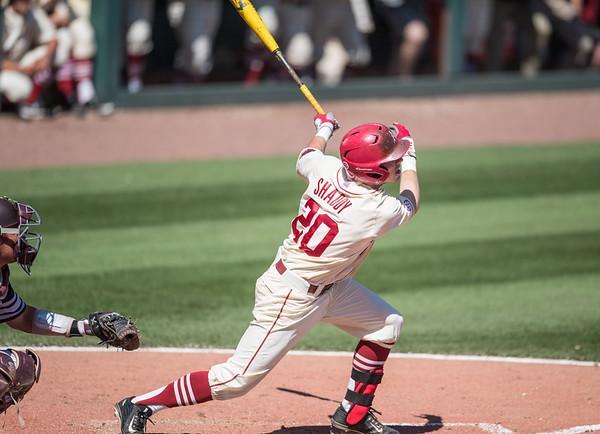 Arkansas catcher Carson Shaddy (20) hits a home run during a baseball game between Arkansas and Texas A&M University on 5/1/2016.   (Alan Jamison, Nate Allen Sports Service)