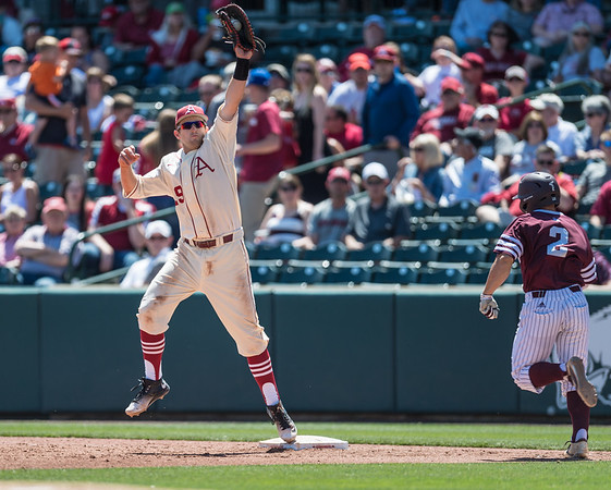 Arkansas infielder Cullen Gassaway (29) records the out at first base during a baseball game between Arkansas and Texas A&M University on 5/1/2016.   (Alan Jamison, Nate Allen Sports Service)