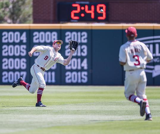 Arkansas outfielder Clark Eagan (9) fields a fly ball during a baseball game between Arkansas and Texas A&M University on 5/1/2016.   (Alan Jamison, Nate Allen Sports Service)