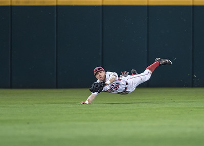 Arkansas Razorbacks catcher Carson Shaddy (20) dives to catch the ball in center field during a baseball game between Alabama and Arkansas on May 13, 2016.   (Alan Jamison)