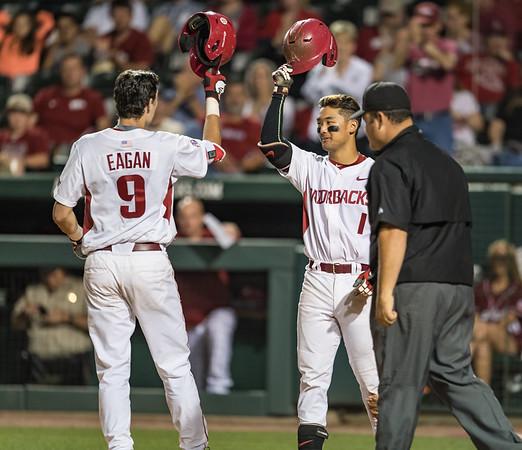 Arkansas Razorbacks infielder Rick Nomura (1) congratulates Clark Eagan (9) on Eagan's home run during a baseball game between Alabama and Arkansas on May 13, 2016.   (Alan Jamison)