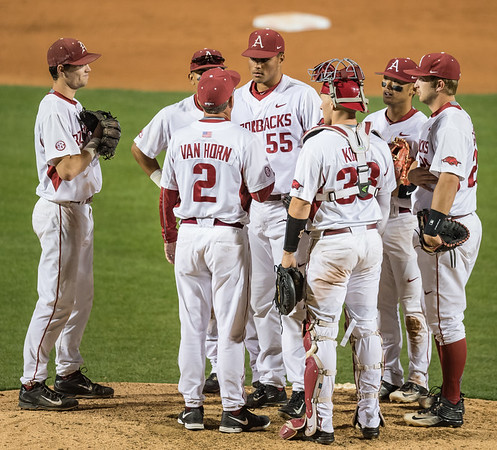 Arkansas head coach Dave Van Horn visits with Isaiah Campbell (55) on the mound during a baseball game between Alabama and Arkansas on May 13, 2016.   (Alan Jamison)