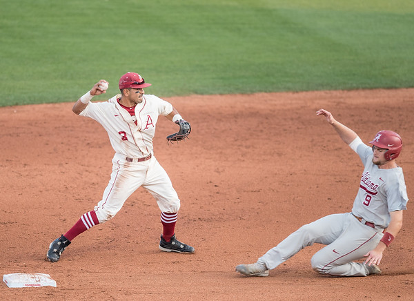 Arkansas senior Michael Bernal (3) throws to first to complete a double play during a baseball game between Alabama and Arkansas on May 14, 2016.   (Alan Jamison)
