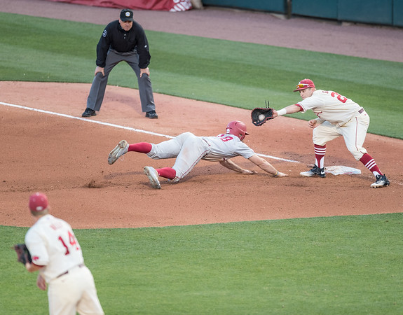 Arkansas Razorbacks infielder Cullen Gassaway (29) tags Alabama Crimson Tide outfielder Keith Holcombe (18) at first base during a baseball game between Alabama and Arkansas on May 14, 2016.   (Alan Jamison)