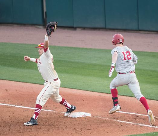 Arkansas senior Cullen Gassaway (29) completes a double play during a baseball game between Alabama and Arkansas on May 14, 2016.   (Alan Jamison)