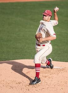 Arkansas Razorbacks pitcher Keaton McKinney (11) pitches during a baseball game between Alabama and Arkansas on May 14, 2016.   (Alan Jamison)