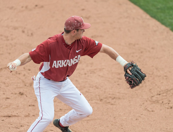 Arkansas Razorbacks infielder Cody Scroggins (5) fields at third base during a baseball game between Alabama and Arkansas on May 15,  2016.   (Alan Jamison, Nate Allen Sports Service)