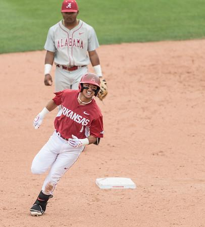 Arkansas Razorbacks infielder Rick Nomura (1) runs the bases after hitting a home run during a baseball game between Alabama and Arkansas on May 15,  2016.   (Alan Jamison, Nate Allen Sports Service)