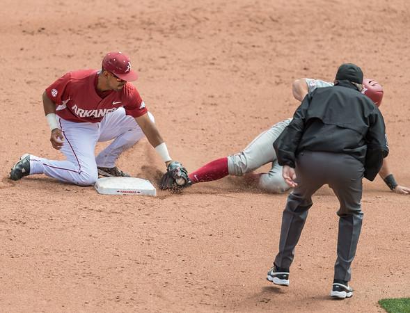 Arkansas Razorbacks infielder Michael Bernal (3) tags out an Alabama baserunner during a baseball game between Alabama and Arkansas on May 15,  2016.   (Alan Jamison, Nate Allen Sports Service)