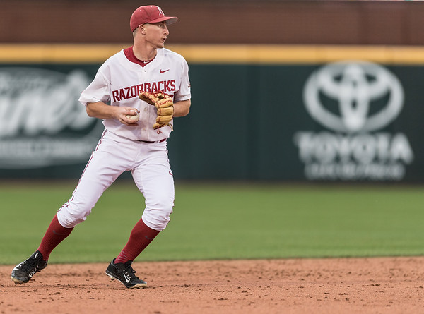 Arkansas infielder Jax Biggers (9) fields during the opening day baseball game between Arkansas and Miami (Ohio) on Friday. 2/17/2017.  (Alan Jamison, Nate Allen Sports Service)