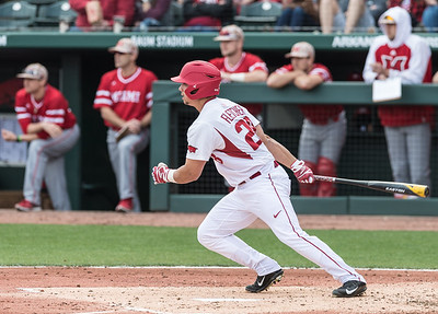 Arkansas outfielder Dominic Fletcher (28) gets a hit during his first collegiate at bat during the opening day baseball game between Arkansas and Miami (Ohio) on Friday. 2/17/2017.  (Alan Jamison, Nate Allen Sports Service)