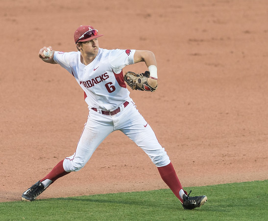 Arkansas infielder Hunter Wilson (6) fields during the opening day baseball game between Arkansas and Miami (Ohio) on Friday. 2/17/2017.  (Alan Jamison, Nate Allen Sports Service)