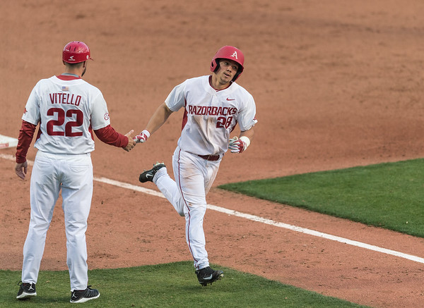 Arkansas outfielder Dominic Fletcher (28) homers during his first collegiate game during the opening day baseball game between Arkansas and Miami (Ohio) on Friday. 2/17/2017.  (Alan Jamison, Nate Allen Sports Service)