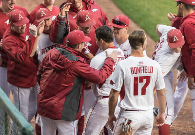 Teammates congratulate Arkansas outfielder Dominic Fletcher (28) after his home run during the opening day baseball game between Arkansas and Miami (Ohio) on Friday. 2/17/2017.  (Alan Jamison, Nate Allen Sports Service)